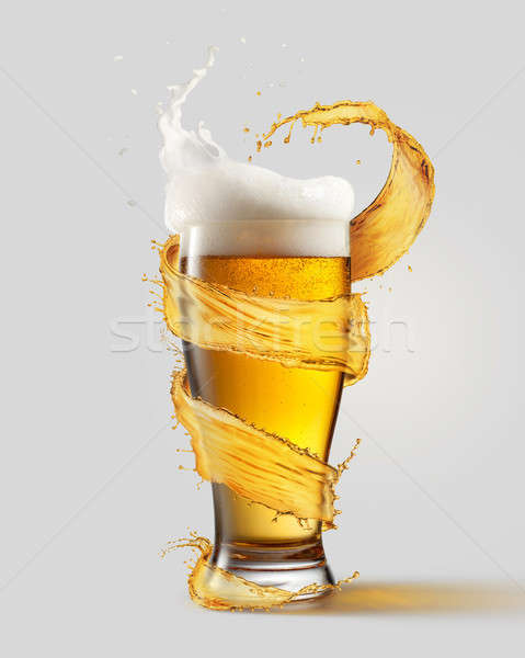 A cold glass of beer and a splash Stock photo © artjazz