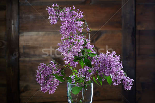 Lilac flowers against wooden background Stock photo © artjazz