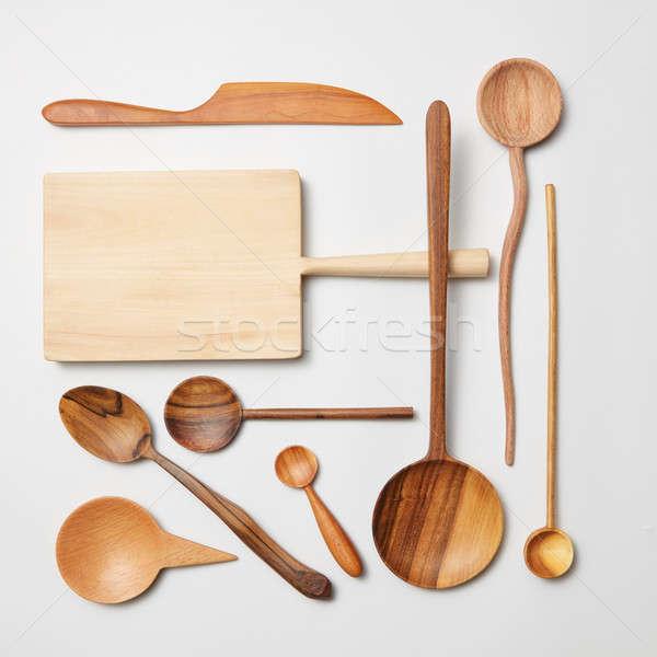 Various kitchen utensil on white wooden background Stock photo © artjazz