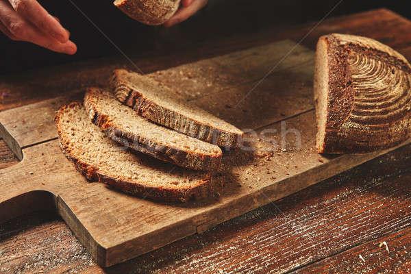 Sliced bread on a board Stock photo © artjazz