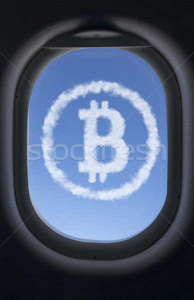 Icono bitcoin nubes cielo azul avión ventana Foto stock © artjazz