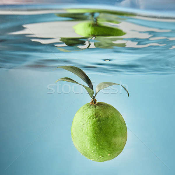 Ripe lime with leaves falls into the water Stock photo © artjazz