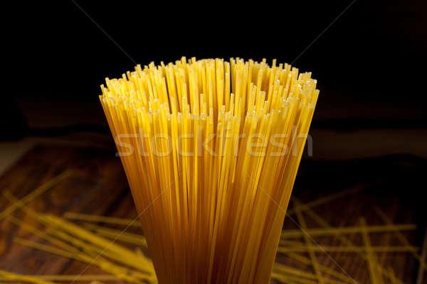 italian spaghetti on black Stock photo © artjazz