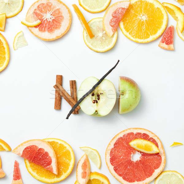 Sliced citrus fruits background closeup Stock photo © artjazz