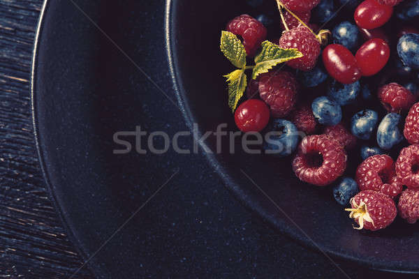 Close up of bowl full with fresh organic berries Stock photo © artjazz