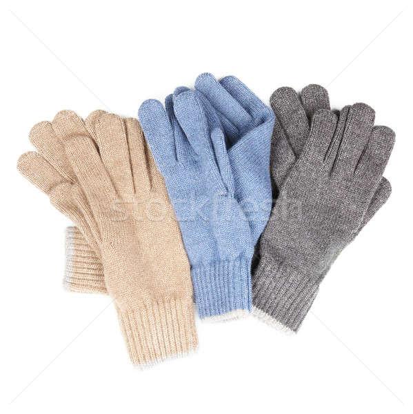 three pairs of knitted gloves Stock photo © artjazz