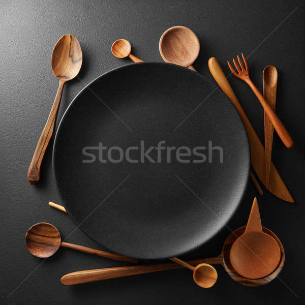 setting empty plate and wooden cutlery Stock photo © artjazz
