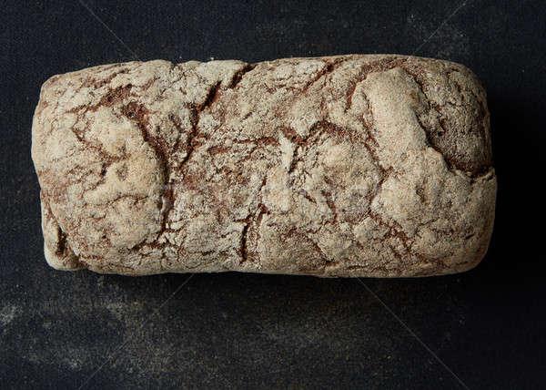 Rustique pain pain sombre isolé noir Photo stock © artjazz