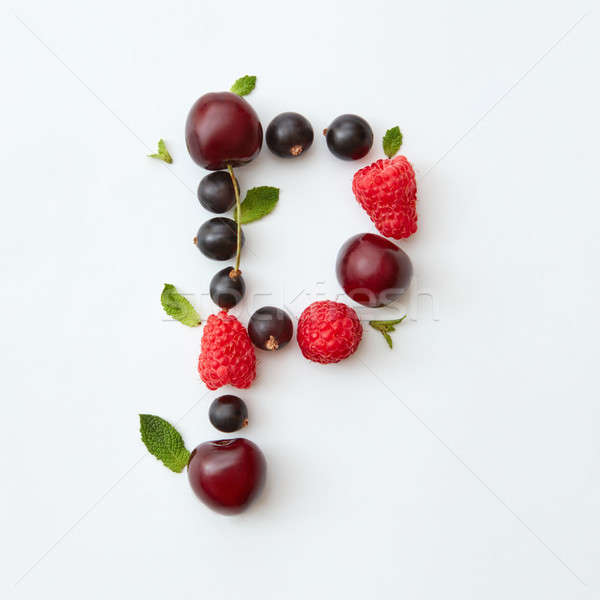 Berries pattern of letter P english alphabet from natural ripe berries - black currant, cherries, ra Stock photo © artjazz