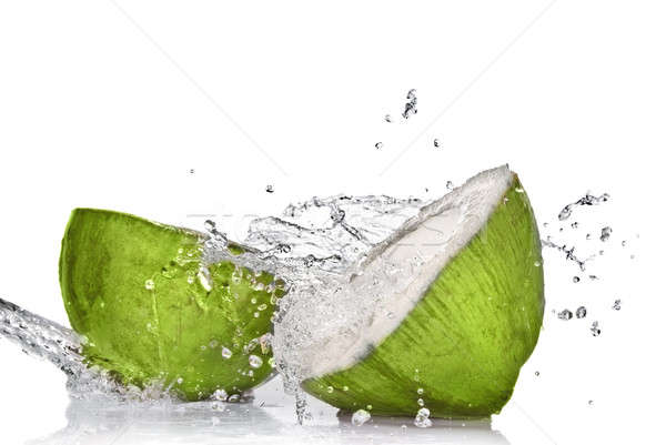 Green coconut with water splash isolated on white Stock photo © artjazz