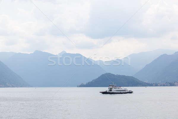 Boot bergen meer water natuur sneeuw Stockfoto © artjazz