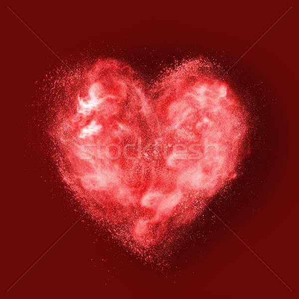 heart made of powder explosion on red Stock photo © artjazz