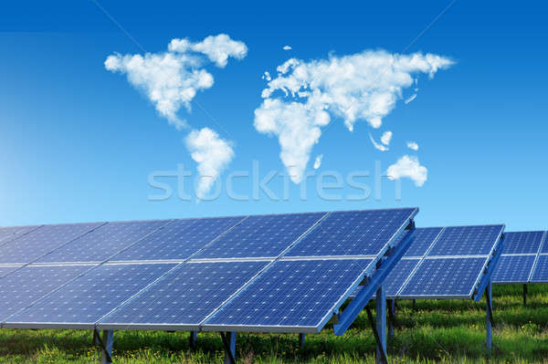 solar panels with world map in sky Stock photo © artjazz