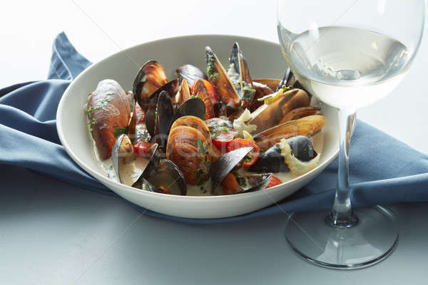 Mussel with white wine sauce on table Stock photo © artjazz