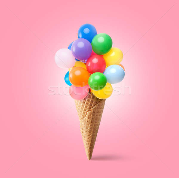 Waffle cornet with balloons Stock photo © artjazz