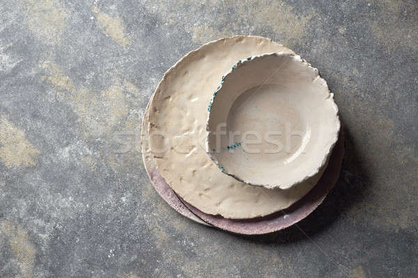 Traditional decorative handcrafted clay dishes, covered with glazed on a gray background. Stock photo © artjazz