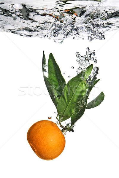 Splash orange Wasser Blasen Luft Blatt Stock foto © artjazz