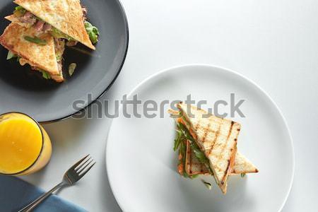 Klub szendvics lazac zöldségek tányér friss narancslé Stock fotó © artjazz