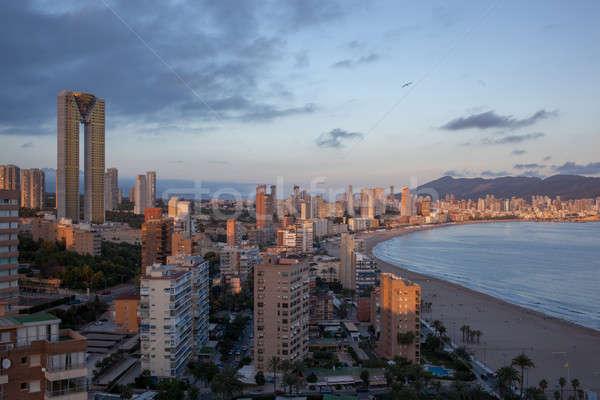 Pôr do sol panorama costa praia cidade paisagem Foto stock © artjazz