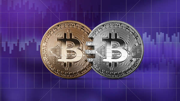 Coins bitcoin on an ultraviolet background, money transfer concept. Stock photo © artjazz