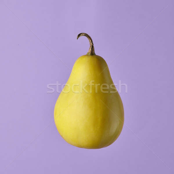 Delicious yellow pear in air on purple background Stock photo © artjazz
