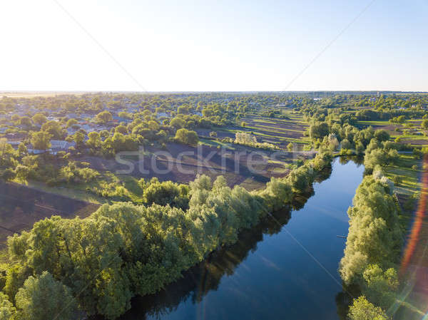 aerial view of a blue lake, green forest and blue sky Stock photo © artjazz