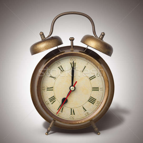 Brown old style alarm clock with shadow Stock photo © artjazz