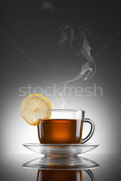 cup of hot tea with lemon and steam Stock photo © artjazz