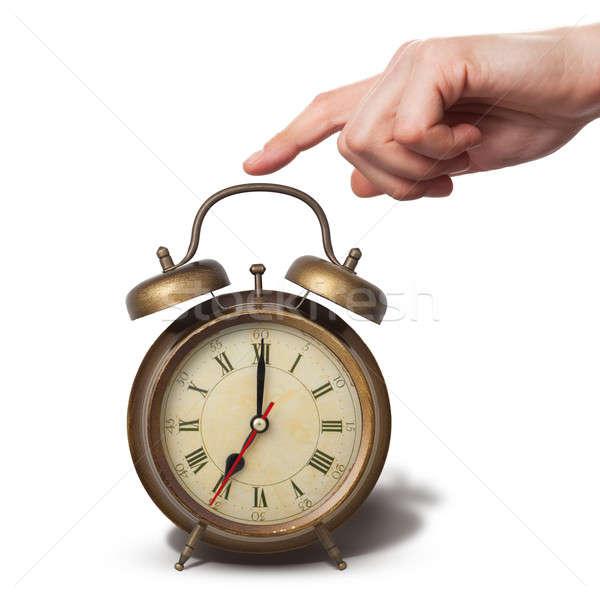 Barna öreg stílus ébresztőóra kéz izolált Stock fotó © artjazz