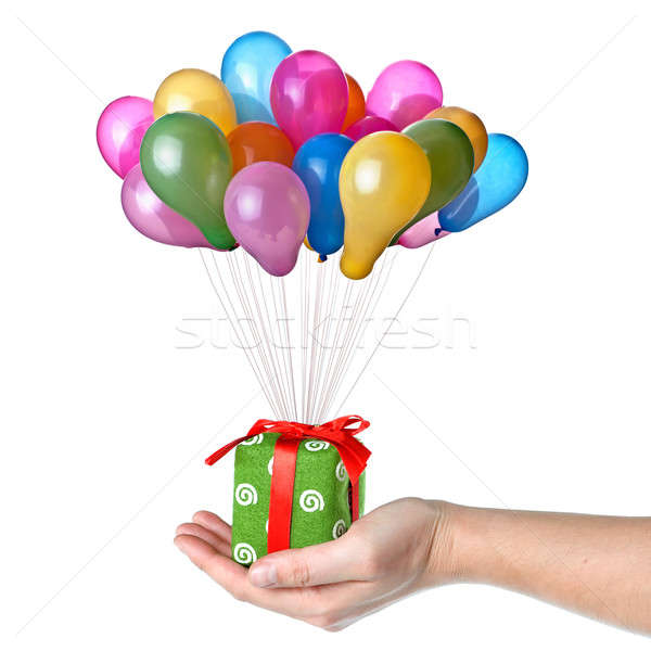 Hand holding gift with color balloons isolated on white Stock photo © artjazz