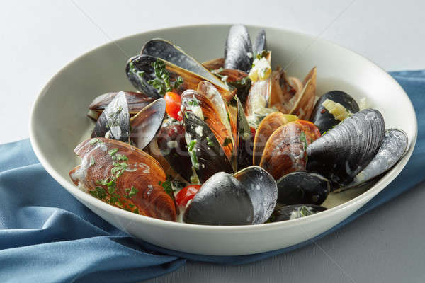 dish of mussels pics with tomato sauce Stock photo © artjazz