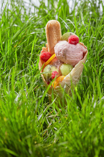 Stock photo: Ice cream with fruit in a waffle cone
