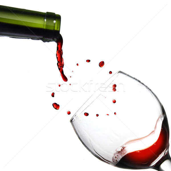 Heart from pouring red wine in goblet isolated on white Stock photo © artjazz