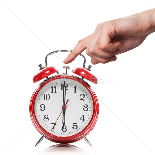 hand and red old style alarm clock isolated on white Stock photo © artjazz