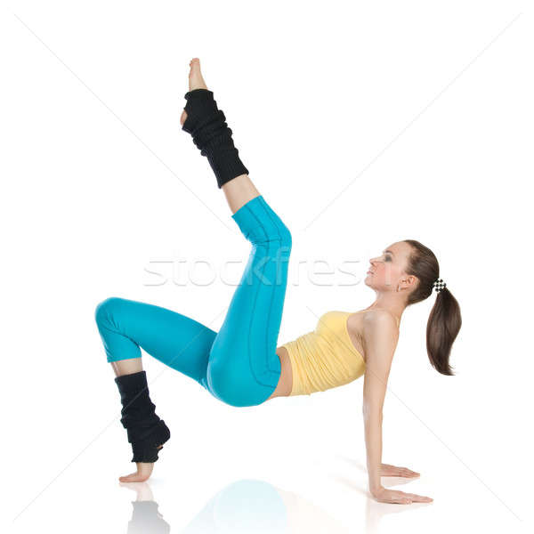 attractive woman doing gymnastics on white background Stock photo © artjazz