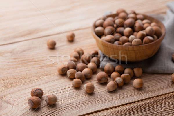 Hazelnuts on wooden table Stock photo © artjazz