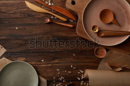 Wooden table with cooking utensils Stock photo © artjazz