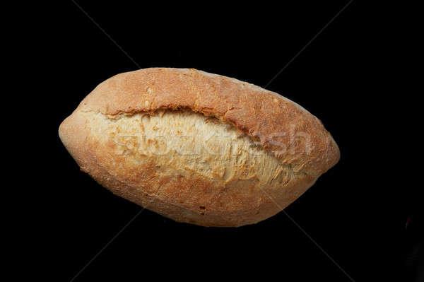 Um pão pão feito à mão saboroso preto Foto stock © artjazz
