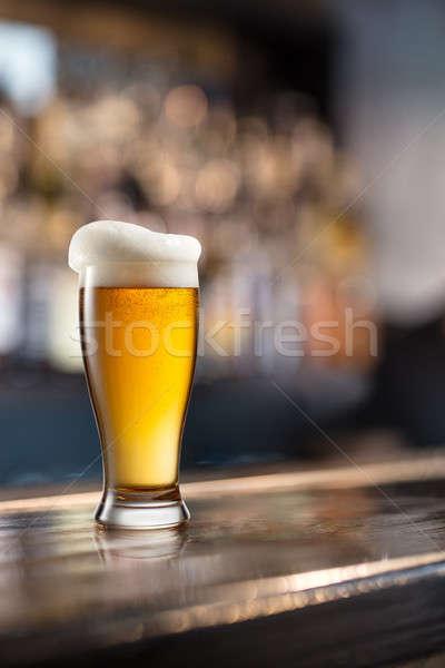 üveg világos sör sötét kocsma felszolgált fából készült Stock fotó © artjazz