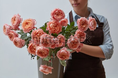 in girl hands bouquet with pink ranunculus isolated on white background. Stock photo © artjazz