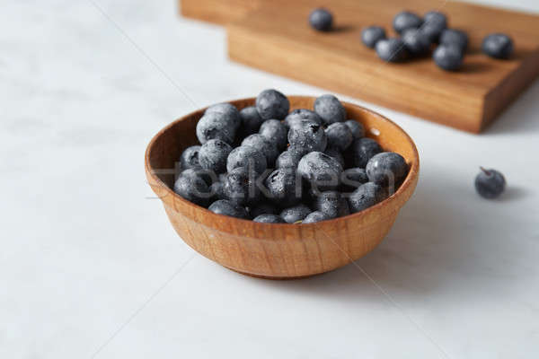 Natural freshly picked blueberries for cooking sweet desserts on kitchen table. Stock photo © artjazz