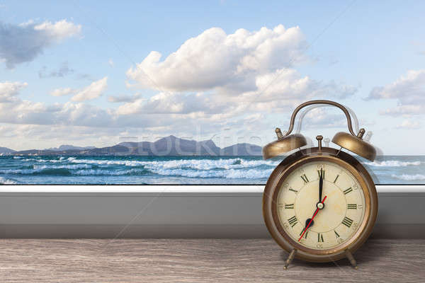 View of summer sea under blue sky from window with alarm clock Stock photo © artjazz