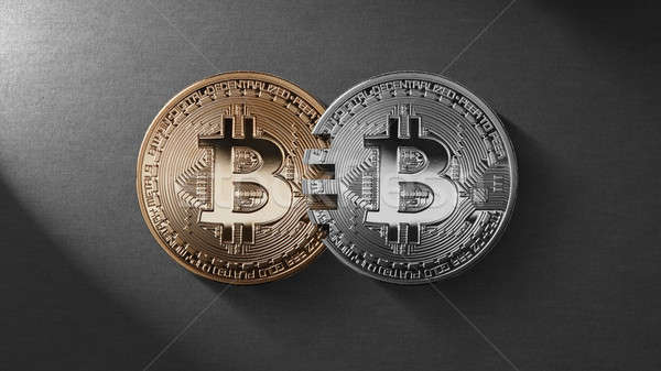 Stock photo: Two coins bitcoin on a black background money transfer concept.