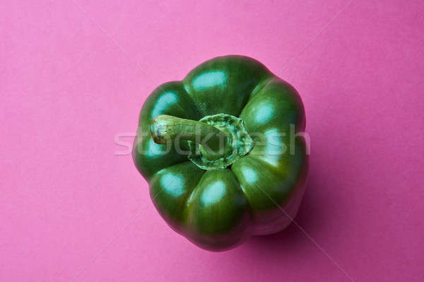 Organic green Bellpepper isolated on pink background Stock photo © artjazz