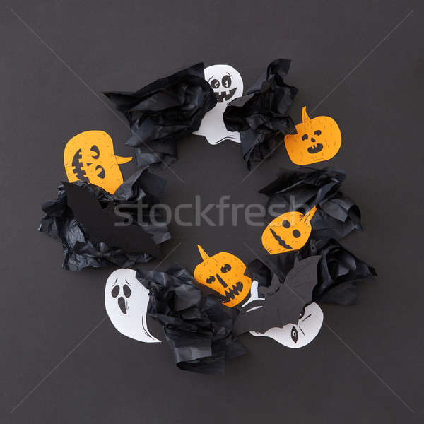 Decorative frame from round flying floating white ghost spirit and smiling yellow pumpkins, black ba Stock photo © artjazz