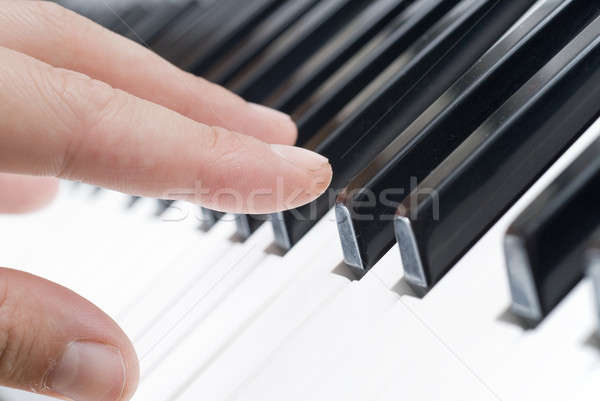 Stock photo: hand playing music on the piano