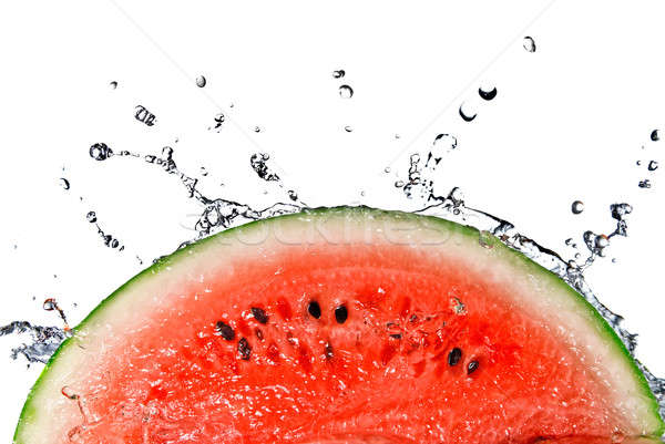 watermelon and water splash isolated on white Stock photo © artjazz
