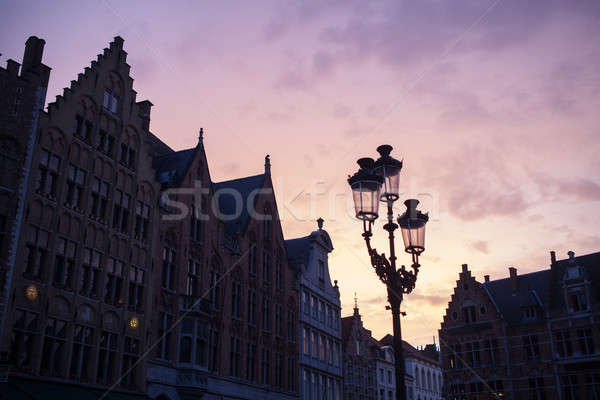 Silhouettes of city center houses in Bruges against beautiful su Stock photo © artjazz