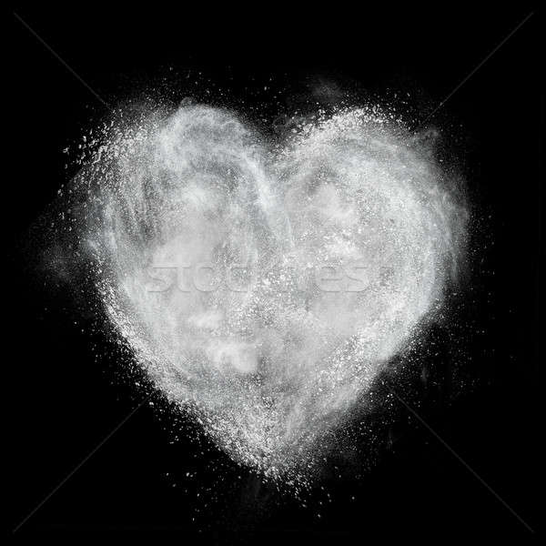 heart made of white powder explosion isolated on black Stock photo © artjazz