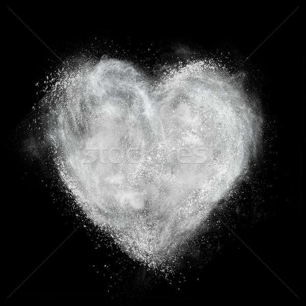 Corazón blanco polvo explosión aislado negro Foto stock © artjazz